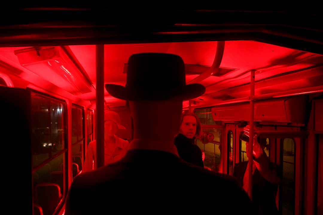 The Man in Red light amoung the manekenes