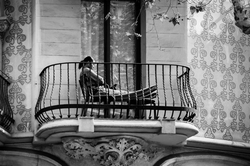 Woman sitting on the Balcony, Barcelona, Spain 2014