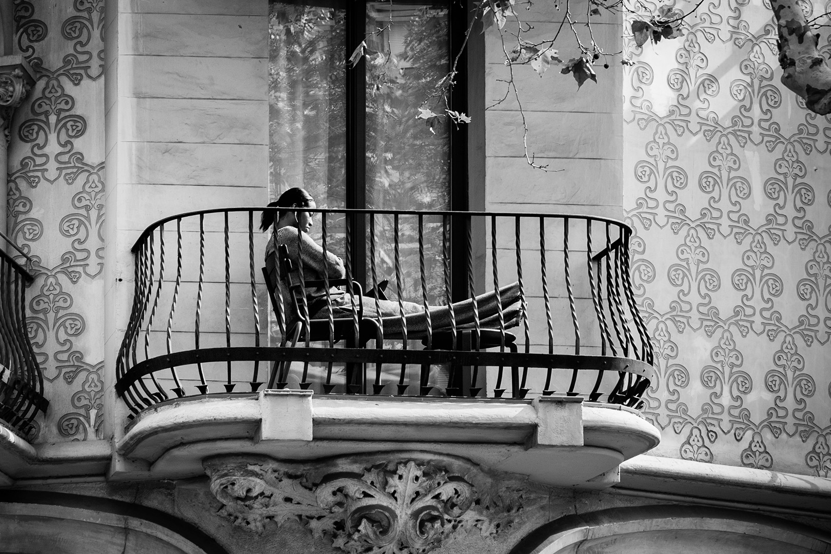 Woman sitting on the Balcony, Barcelona, Spain 2014
